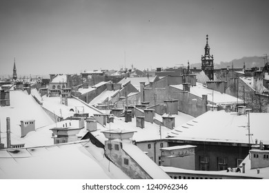 Krakow in Christmas time, aerial view on snowy roofs in central part of city. BW photo. Poland. Europe.