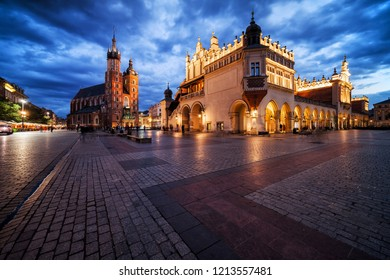 Krakow city in the evening in Poland, Main Square in the Old Town, illuminated St. Mary Church and Cloth Hall (Sukiennice).