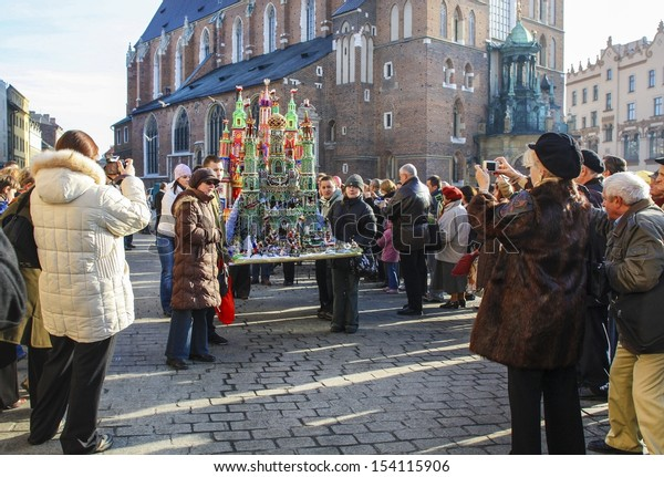 KRAKOW - DECEMBERS 04: Participants of annual Nativity Scenes Contest are taking their crafts to museum at Krzysztofory Palace, where jury of contest is located. Krakow, Poland on December 02, 2008.