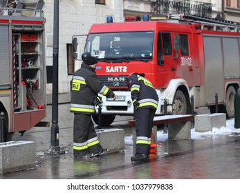 Krakow, Grodska  street, Poland - 02.26.2018: Exercises fire brigade in the old part of the city in the winter. Elimination of fire and natural disasters. Emergency response service.