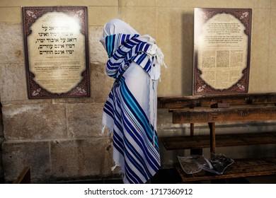 Krakow, Kazimierz, Poland. 10.23.2013 Jewish man is covering himself with a Talit at the Izaak Synagogue, Kazimierz.