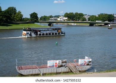 KRAKOW, LESSER POLAND / POLAND - JUNE 06, 2019: Vistula Embankment  and tourist boats on the river