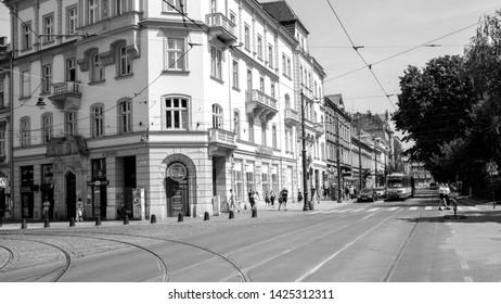 Krakow, Malopolskie, Poland - June 15 2019 : sommer day in Krakow on black and white photos. Dietla street