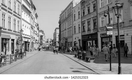 Krakow, Malopolskie, Poland - June 15 2019 : sommer day in Krakow on black and white photos. Street view