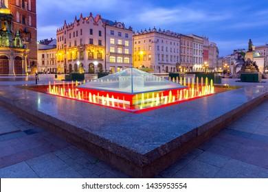 Krakow. Market square in the night lights at sunrise.