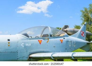 KRAKOW MUSEUM OF AVIATION, POLAND - JUL 27, 2014: military training aircraft on exhibition in outdoor museum of aviation history in Krakow, Poland. In summer often airshows take place here.