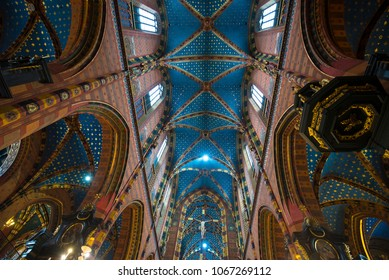 Krakow, Poland - 01 april , 2018: People visiting the St. Mary's basilica celebrating Easter. The church is located on the Main Market Square and have on of the most beautiful ceiling interior.