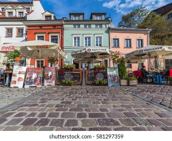 KRAKOW, POLAND -  15TH OCTOBER 2016: Colourful buildings and restaurants in the Kazimierz district of Krakow. People can be seen.