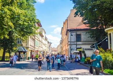 KRAKOW, POLAND, 17 JULY 2018: Main street of Krakow historic cen