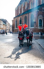 Krakow, Poland - 18 September 2018: White carriage with two black fancy hourses on the Krakow cityspace