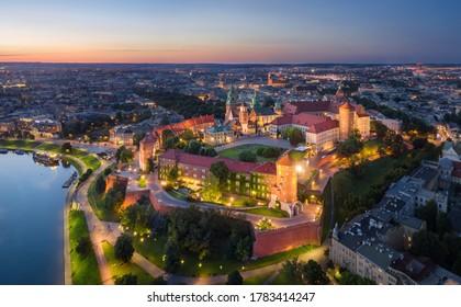 Krakow, Poland. Aerial view of illuminated Wawel Royal Castle on sunset