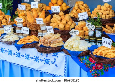 KRAKOW, POLAND - APR 13: Traditional goat cheese and honey jars on Easter market stall on 13 April 2014, Krakow, Poland. Ester fairs take place evey year on main market square of Krakow.