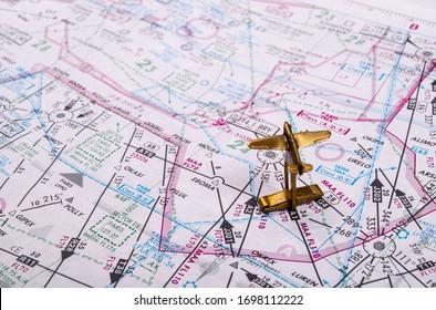 Krakow, Poland -  APRIL 1, 2020: Airplane model on the aviation map. Aircraft Headin, Travel, Flight Planning.