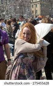 KRAKOW, POLAND - APRIL 11, 2015:  International pillow fight on April 11, 2015 in Old Market Square in Cracow. Poland