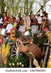 Krakow / Poland - April 17 2011: Folklore group dressed in regional costumes from Krakow during their show on stage decorated with vintage easter decoration, Festival of Easter Tradition
