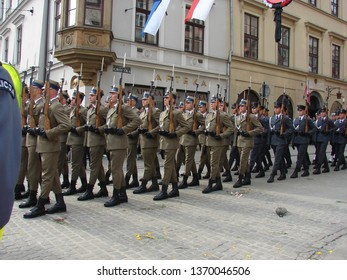 Krakow / Poland - April 18 2010: Soldiers and policemen in gala uniforms march during official ceremonial funeral of tragically died President of Poland Lech kaczynski, street in Krakow