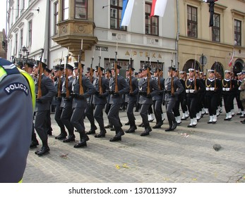 Krakow / Poland - April 18 2010: Polish policemen and marines in gala uniforms with weapons march ceremonially during funeral of tragically died President lech Kaczynski