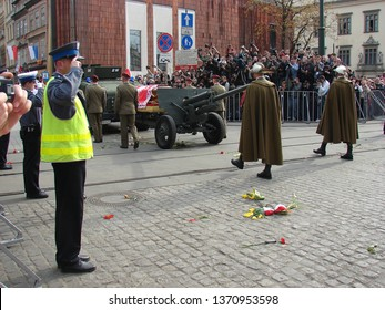 Krakow / Poland - April 18 2010: Ceremony of funeral tragically died President Lech Kaczynski, his coffin on military vehicle, soldiers in gala uniforms, policemen salute, people take photos, Krakow