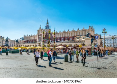 KRAKOW, POLAND - APRIL 19, 2019: Cloth hall (Polish: Sukiennice) in Krakow, Poland. It is the central feature of the main market square in the Old Town.