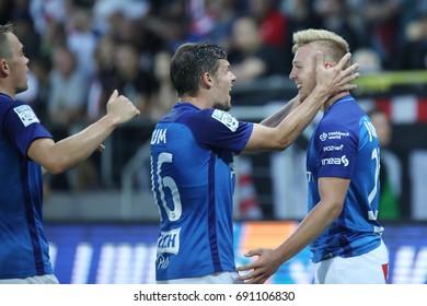 KRAKOW, POLAND - AUGUST 06, 2017: Polish Premier Football League Cracovia Krakow - Lech Poznan o/p Kamil Jozwiak, Mario Situm