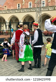 KRAKOW, POLAND - August 10, 2018:  Dancers dressed in traditional folk costumes before going on stage for their performance during the 42nd International Folk Art Fair in Krakow Main Market Square.