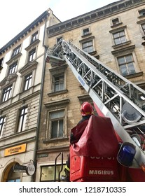 KRAKOW, POLAND - August 10, 2018: A fire department vehicle with extended ladder at the scene of a fire in one of the buildings in a historical district of Krakow.