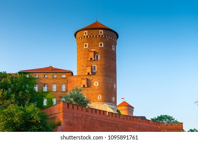Krakow, Poland - August 11, 2017: high brick tower - Wawel castle in the suumer day against the blue sky