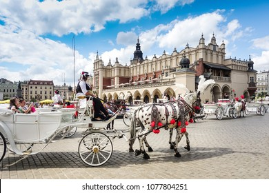KRAKOW, POLAND - August 27, 2017: a horse and carriage carries tourists in Krakow, Poland