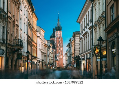 Krakow, Poland - August 27, 2018: View Of St. Mary's Basilica From Florian Street. Famous Landmark Old Landmark Church Of Our Lady Assumed Into Heaven. Saint Mary's Church. UNESCO World Heritage Site