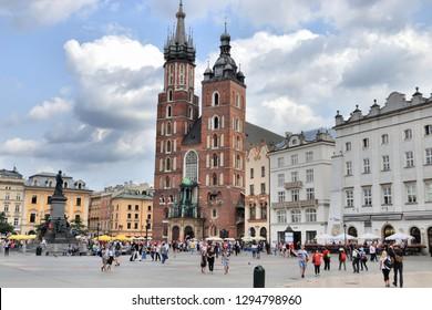 KRAKOW, POLAND - AUGUST 28, 2018: People visit Rynek square in Krakow, Poland. The Historic Centre of Krakow is a UNESCO World Heritage Site.