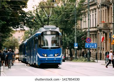 Krakow, Poland - August 28, 2018: Blue Public Tram On Basztowa Street In Krakow.