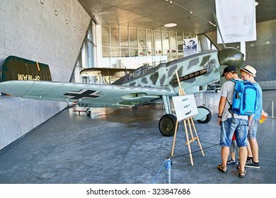 Krakow,  Poland - August 30, 2015: People visiting, walking (inside ) the museum of aviation history. Exhibition planes in the museum. It'??s one of the largest, famous museums in Krakow. Copy space.