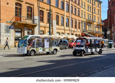 Krakow, Poland. August 7, 2016: Typical sightseeing electric cars in Old Town in Cracow. Poland, Europe.