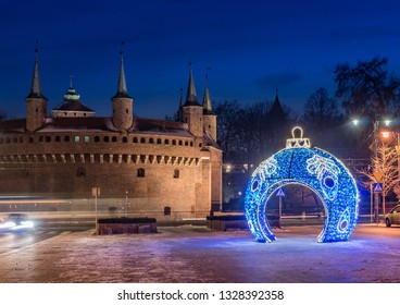 Krakow, Poland, Christmas decoration and barbican in the night