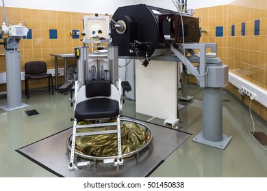 Krakow, Poland, circa May 2016. Proton therapy of eyeball cancer in the Bronowice Cyclotron Center at the Institute of Nuclear Physics. A patient positioning chair in a treatment room.