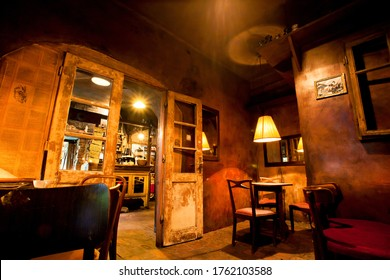 KRAKOW, POLAND: Cozy rooms with vintage interior of old restaurant, and lamps, chairs, old style without visitors on August 6, 2019. Krakow has 2.35 mill. foreign tourists annually