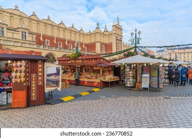 KRAKOW, POLAND - DEC 10, 2014: traditional Christmas market in Krakow. Many tourists visit this famous European city to buy traditional products of Poland and enjoy Christmas time.