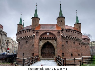 KRAKOW, POLAND - DECEMBER 10, 2019: Panoramic view of the Krakow Barbican a fortified outpost - is a historic gateway leading into the Old Town of Krakow, Poland
