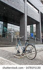 KRAKOW, POLAND - DECEMBER 12, 2018: Bike stand by the Jagiellonian University modern building in Krakow, Poland.