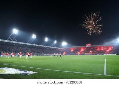 KRAKOW, POLAND - DECEMBER 13, 2017: Polish Premier Football League Cracovia Krakow - Wisla Krakow o/p football fans, pyrotechnics