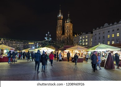 KRAKOW, POLAND - DECEMBER 15, 2016: Christmas market at the Main square (Rynek Glowny) in front of St. Mary's Basilica. The market starts in the last week of November and lasts through December 26th.