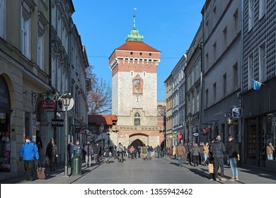KRAKOW, POLAND - DECEMBER 16, 2016: St. Florian's Gate. It is one of the best-known Polish Gothic towers, and a focal point of Krakow's Old Town. It was built about the 14th century.