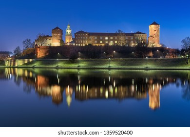 KRAKOW, POLAND - DECEMBER 16, 2016: Wawel Hill with Wawel Royal Castle and fragment of Wawel Cathedral at dawn. View from the bank of Vistula river.