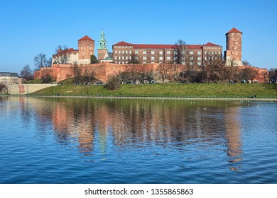 KRAKOW, POLAND - DECEMBER 17, 2016: Wawel Hill with Wawel Royal Castle and fragment of Wawel Cathedral (Archcathedral Basilica of Saints Stanislaus and Wenceslaus). View from the bank of Vistula river
