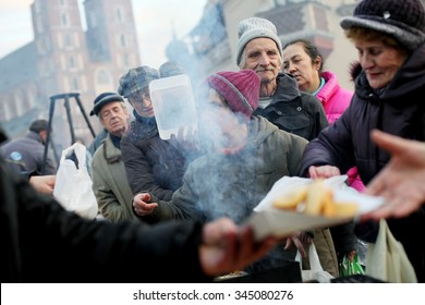 KRAKOW, POLAND - DECEMBER 22, 2013; Christmas Eve for poor and homeless on the Central Market in Cracow. Every year the group Kosciuszko prepares the greatest eve in the open air in Poland.