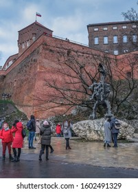 Krakow, Poland - December 24, 2019:  Wawel Dragon statue at the foot of Wawel Royal Castle Hill, dedicated to the mythical, breathing fire  Dragon of Wawel in the polish folklore legend.