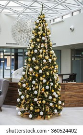 KRAKOW, POLAND - DECEMBER 26, 2015: Traditional big christmas tree inside the modern building in Krakow, Poland.