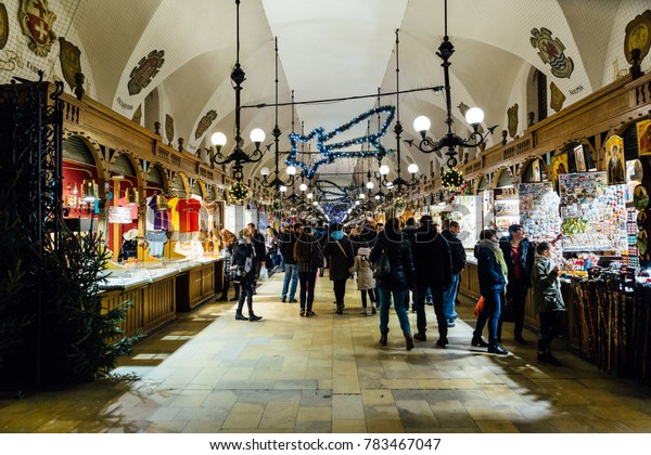 Krakow, Poland - December 28, 2017: The crowded Cloth Hall gallery, or Sukiennice, located on Rynek Glowny, the main market square in the old town of Krakow.