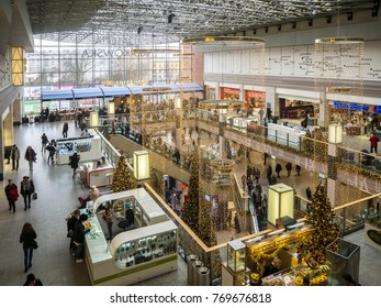 KRAKOW, POLAND - DECEMBER 5, 2017: Christmas decoration, Christmas trees; escalators and people shopping in Galeria Krakowska multilevel  hypermarket at main railway station in Krakow, Poland