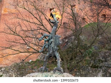 KRAKOW, POLAND - DECEMBER 9, 2019: Wawel Dragon Statue - a monument at the foot of the Wawel Hill in Krakow, Poland